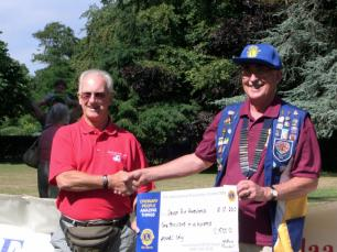 Cheque presentation to Devon Air Ambulance, by Sidmouth Lions President Ian Skinner at the July 2010 Duck race