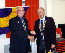 Lion Ian Skinner (on left) hands over the Club Presidency to Lion Chris Rignall on 25th June 2011