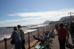 Enjoying the sunshine on Sidmouth sea-front