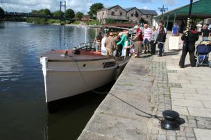 Boarding the boat for the Exeter Canal - a Sidmouth Lions social outing
