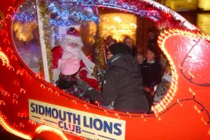 Santa greets some young visitors to Santa\\\'s float at the Sidmouth Late Night Shopping event - 3 December 2010