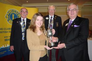 Rachael Hill receiving the Young Ambassador South West District winner\'s award from Lions International 2nd Vice President Wayne Madden, with District Governor Neil Rutter and Sidmouth Lions President Ian Skinner