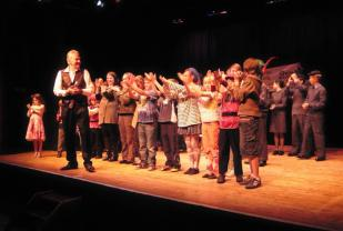 Baz Breadmore on stage with the younger performers at the end of the finale to the Youth Variety Show - April 2011
